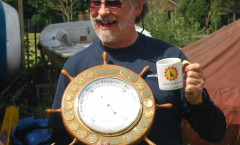 Ray  holding the Regatta Trophy -a ship's wheel presented to the club by founder member