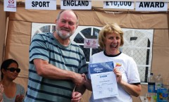 Commodore and Secretary share the good news at Club  Regatta BBQ